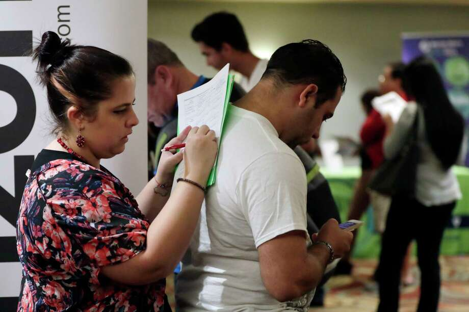 FILE- In this Jan. 30, 2018, file photo, Loredana Gonzalez, of Doral, Fla., fills out a job application at a JobNewsUSA job fair in Miami Lakes, Fla. On Friday, Nov. 2, the U.S. government issues the October jobs report. (AP Photo/Lynne Sladky, File) Photo: Lynne Sladky / Copyright 2018 The Associated Press. All rights reserved.