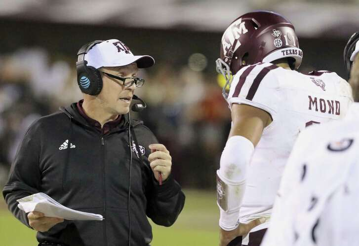 Texas A&M head coach Jimbo Fisher, left, talks to quarterback Kellen Mond (11) during the second half of an NCAA college football game against Mississippi State, Saturday, Oct. 27, 2018, in Starkville, Miss. (AP Photo/Jim Lytle)