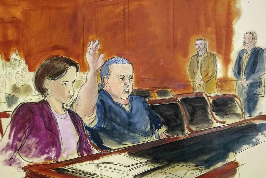 In this courtroom sketch, pipe bombs suspect Cesar Sayoc seated in court, raises his arm to swear to the truth of his statement of need for assigned counsel, during his presentment in Manhattan Federal Court Tuesday, Nov. 6, 2018, in New York. Sayoc, who faces charges for allegedly mailing more than a dozen explosive devices to prominent Democrats, CNN and critics of Republican President Donald Trump, has been ordered held without bail in New York. At left is Federal Defender Sarah Baumgartel, while standing far right are U.S. marshals. (Elizabeth Williams via AP) Photo: Elizabeth Williams / FR142054 AP