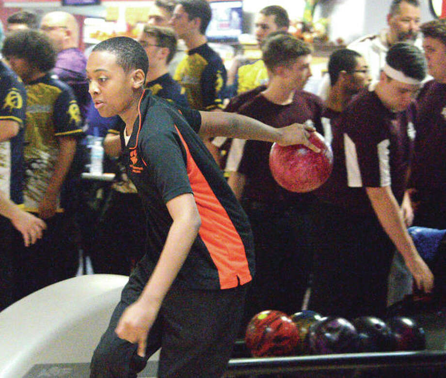 Edwardsville freshman Derrick Newsome bowls on Tuesday at Bowl Haven in Alton on day one of the inaugural Southwestern Conference Tournament.
