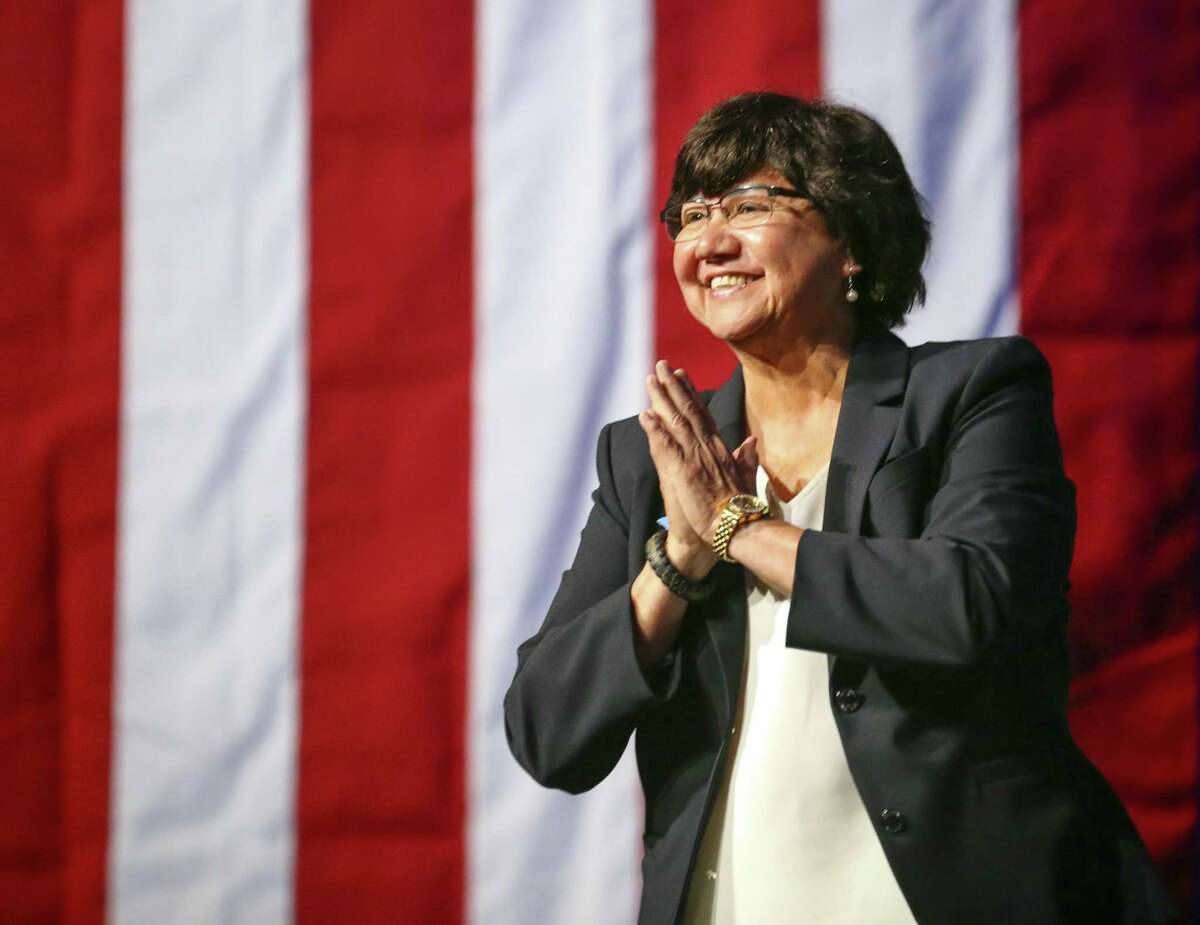 FILE - In this June 22, 2018 file photo, gubernatorial candidate Lupe Valdez is greeted as she takes the stage during the general session at the Texas Democratic Convention in Fort Worth, Texas. Dallas County authorities say a new inventory search has turned up former sheriff Lupe Valdez?'s gun that was reported missing after she stepped down to run for Texas governor. The Dallas County sheriff's department on Tuesday, Aug. 21, 2018, apologized to Valdez for ?
