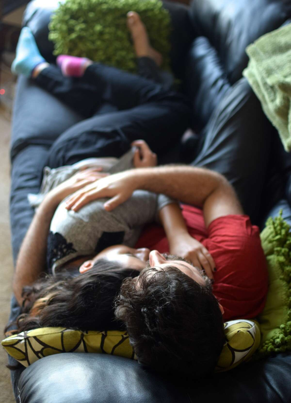 Yoni Alkan, a certified Cuddlist and a Cuddle Party facilitator, cuddles with a client.