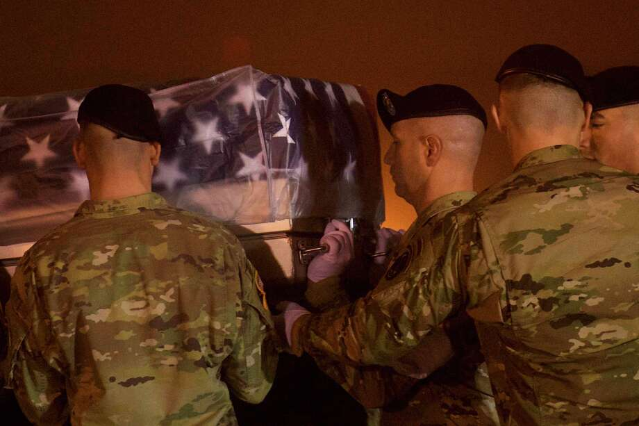 DOVER, DE - NOVEMBER 06:  Armed forces carry a transfer case for fallen service member, Major Brent R. Taylor, during a dignified transfer at Dover Air Force Base on November 6, 2018 in Dover, Delaware.  Taylor, a Utah Mayor, was killed in Afghanistan.  (Photo by Mark Makela/Getty Images) Photo: Mark Makela / 2018 Getty Images
