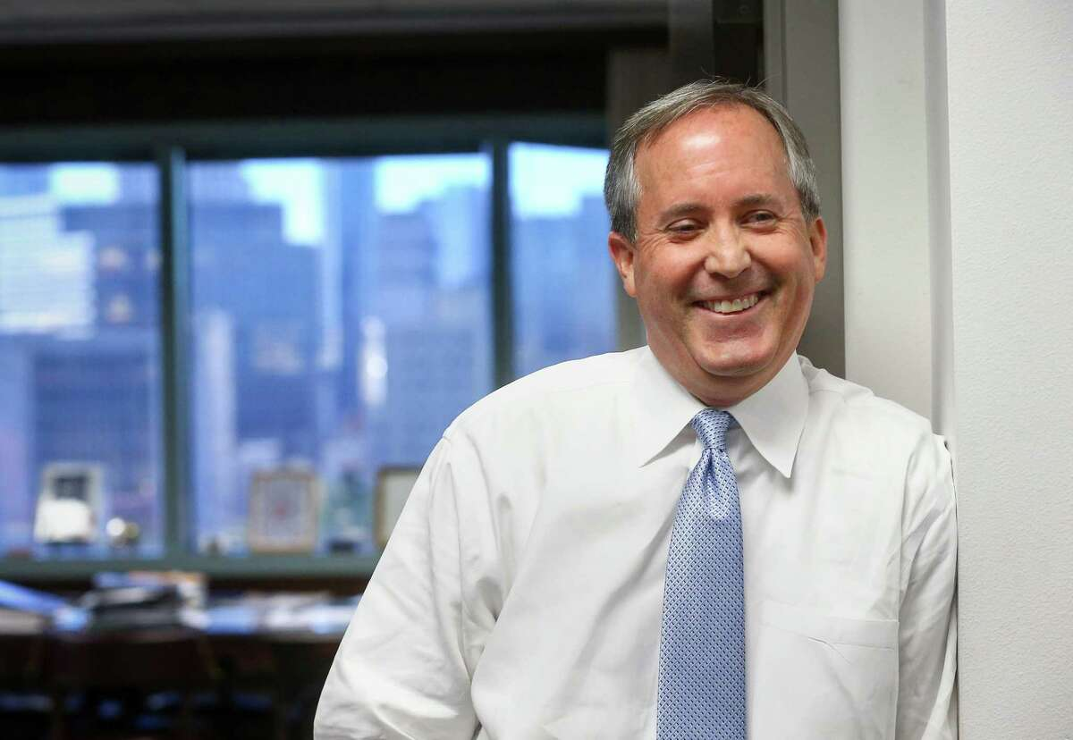 Texas Attorney General Ken Paxton jokes with staff members at his office Friday, Oct. 21, 2016, in Austin. ( Jon Shapley / Houston Chronicle )