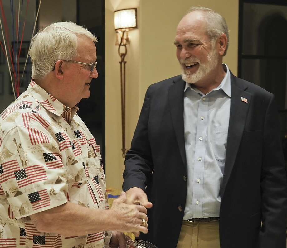 Fred Schwiening congratulates Terry Johnson 11/06/18 evening at a celebration party for Johnson winning Midland County Judge. Tim Fischer/Reporter-Telegram Photo: Tim Fischer/Midland Reporter-Telegram