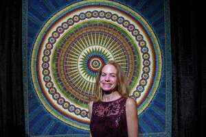 """Sherry Reynolds with her Best of Show Award winner """"Eternal Beauty,"""" at the 2018 International Quilt Festival."""