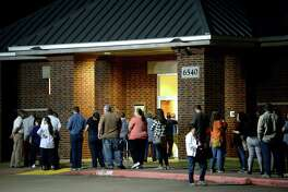 A long line forms outside the community center at Rogers Park as the after-work crowd makes their way to the polls in the final hour of election day voting. Photo taken Tuesday, November 6, 2018 Kim Brent/The Enterprise
