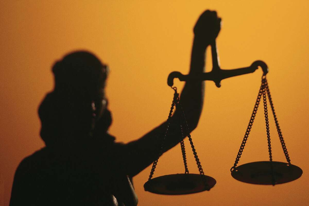 Silhouette of scales of Lady Justice holding scales