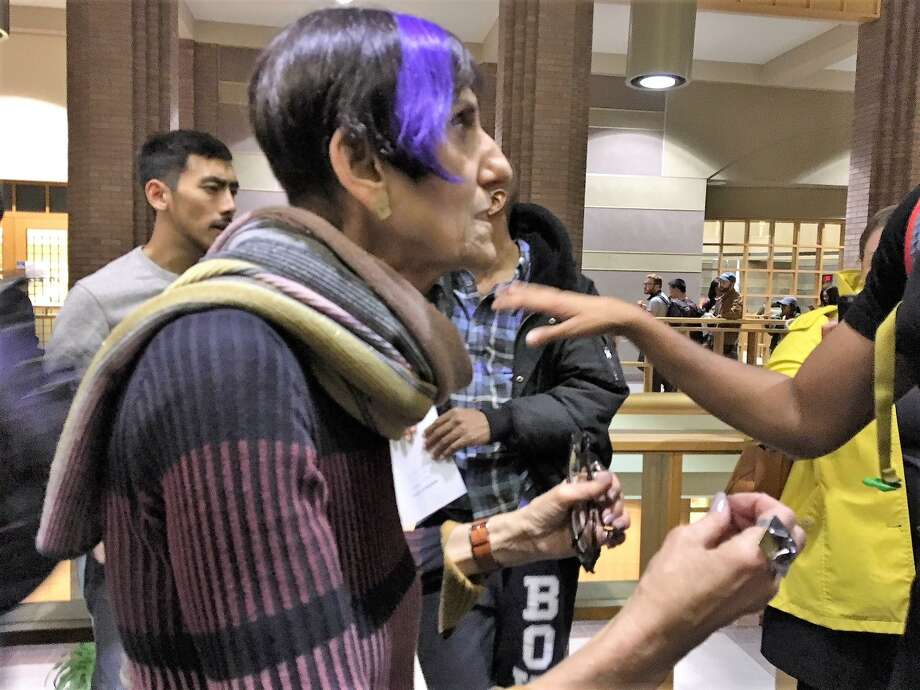U.S. Rep. Rosa DeLauro, D-3, talks with students who had come by to help with registration at New Haven City Hall. She called Mayor Toni Harp to come to the scene many had to wait four hours to register to vote and then cast a ballot. Photo: Mary E. O'Leary / Hearst Connecticut Media