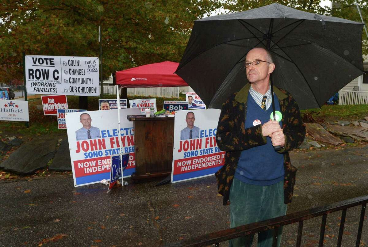 Republican candidate John Flynn campaigns outside Kendall Elementary School for the 140th State Representative seat Tuesday, November 6, 2018, in Norwalk, Conn.