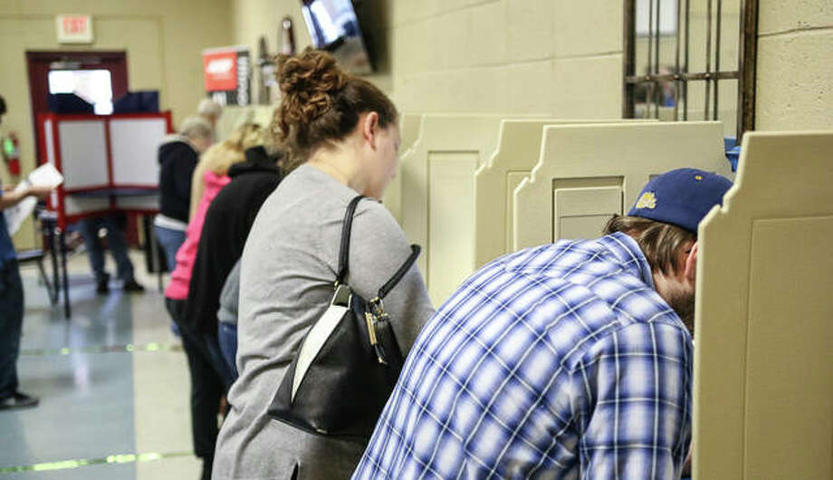 Voters fill out their ballots at a full Senior Services Plus in Alton Tuesday. Photo: Nathan Woodside | The Telegraph