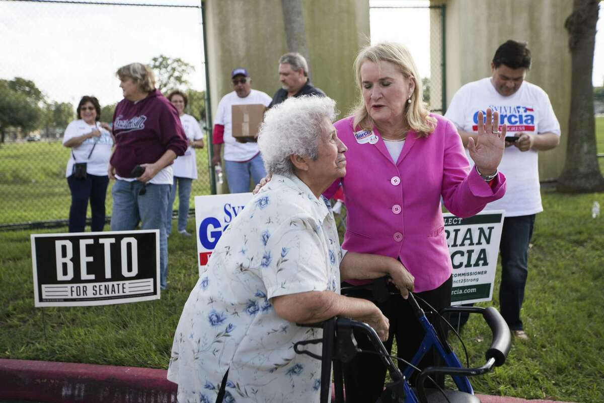 Candidate for United States Representative Texas 29th District Sylvia Garcia talks to voter Theresa Padilla, 81, at the Denver Harbor Comm. Center on Election Day, Tuesday, Nov. 6, 2018, in Houston.