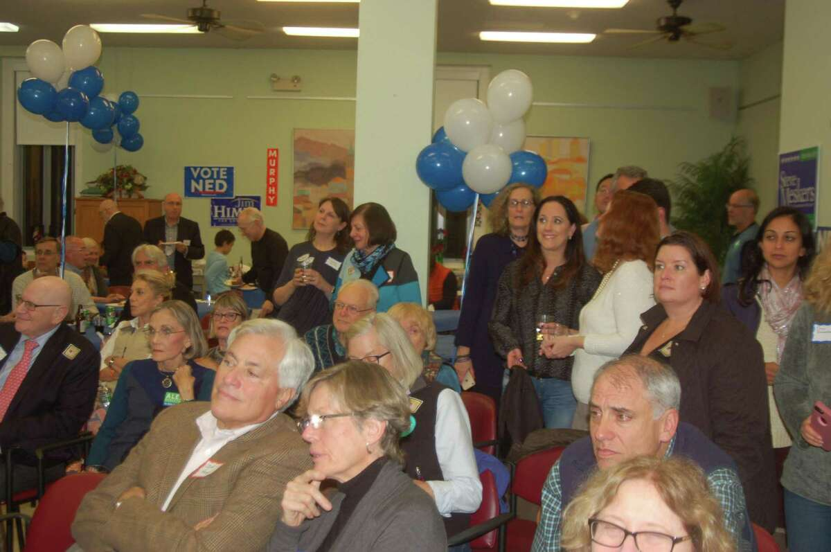The Democratic crowd at the Greenwich Senior Center watches anxiously as the results start to come in Tuesday evening.
