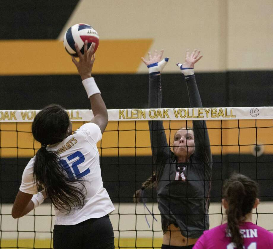 Savanna Meyer of Oak Ridge (11) attempts to block Nena Mbonu of Klein (12) during a Region II-6A quarterfinal volleyball matchup Tuesday, Nov. 6, 2018 at Klein Oak High School in Spring. Photo: Cody Bahn, Houston Chronicle / Staff Photographer / © 2018 Houston Chronicle
