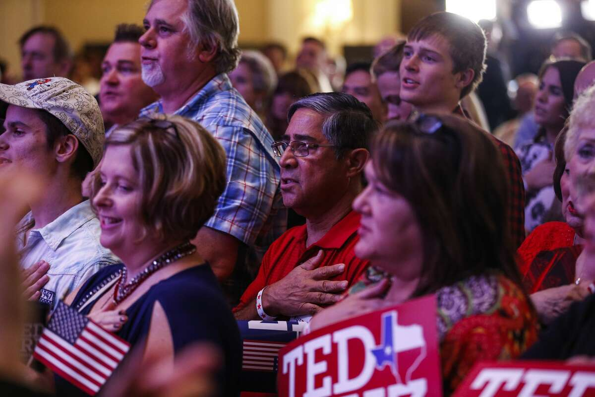 People stand for the pledge of allegiance at the election night event for Senator Ted Cruz at the Hilton Post Oak Ballroom Tuesday, Nov. 6, 2018, in Houston.