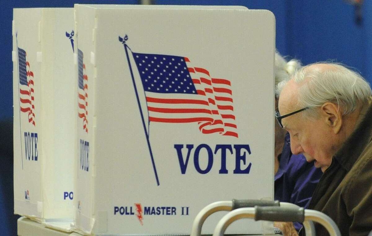 Voters including Charles Daniells cast their ballots at Marvin Elementary School in Norwalk on Tuesday.