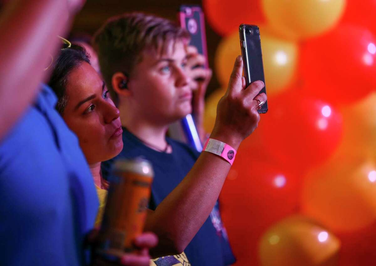 Prop B supporters listen and record as HPFFA members announced results during a watch party at the White Oak Music Hall Tuesday, Nov. 6, 2018, in Houston.