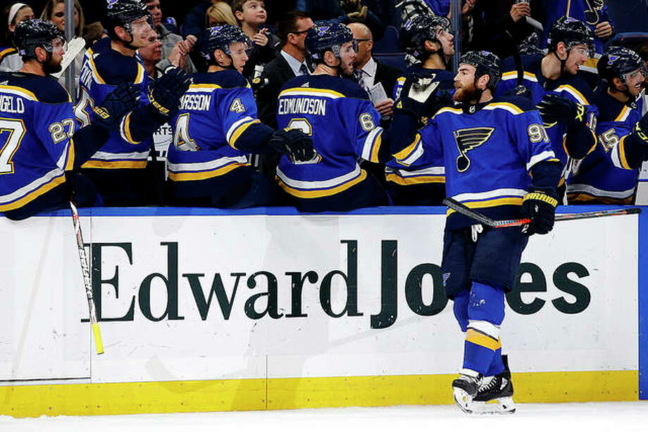The Blues' Ryan O'Reilly is congratulated by teammates after scoring a goal against the Carolina Hurricanes Tuesday night in St. Louis. Photo: Billy Hurst | AP Photo