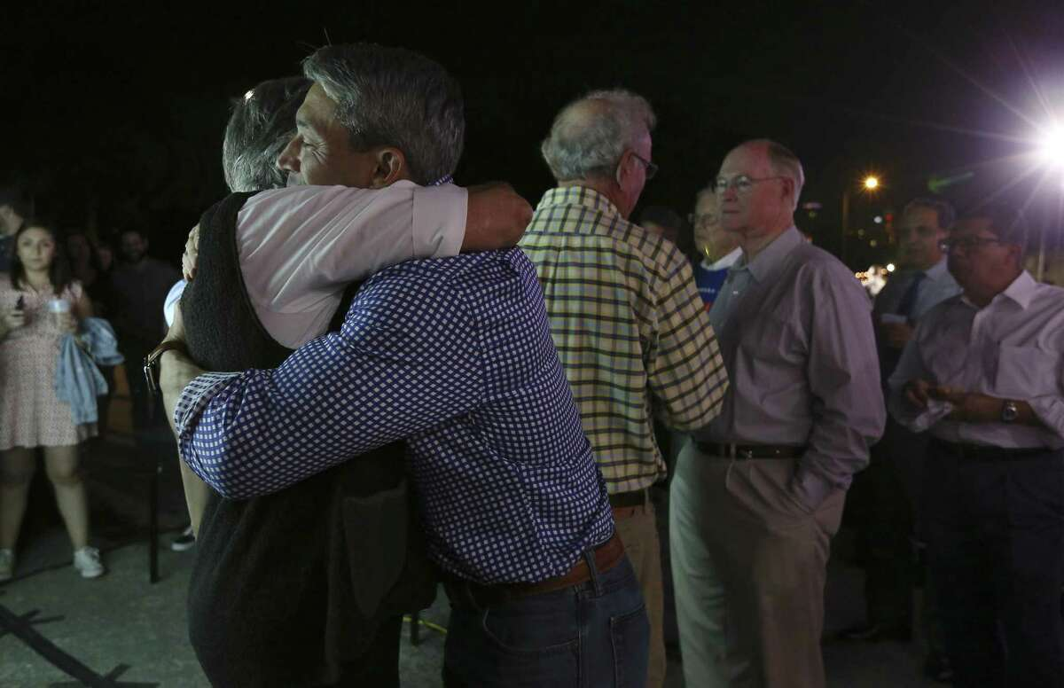 """Mayor Ron Nirenberg hugs Linda Morgan, wife of former mayor Phil Hardberger, at the """"Go Vote No"""" campaign as San Antonio voters decide on three charter amendments supported by the firefighters?' union and blasted by a wide cross-section of community leaders. Supporters in opposition of the three amendments gather on election night to see the results. (Kin Man Hui/San Antonio Express-News)"""