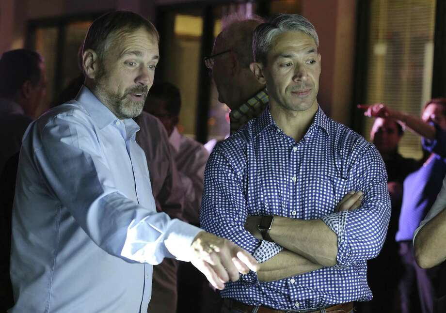 Mayor Ron Nirenberg, right, and campaign manager Christian Archer watch election night results. Nirenberg and the city now have important decisions to make as two of the three amendments passed. Photo: Kin Man Hui /San Antonio Express-News / ©2018 San Antonio Express-News