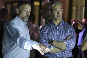Mayor Ron Nirenberg, right, and campaign manager Christian Archer watch election night results. Nirenberg and the city now have important decisions to make as two of the three amendments passed.
