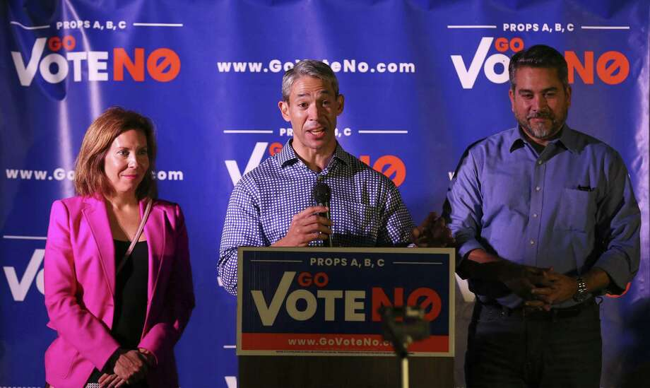 "Mayor Ron Nirenberg, District 5 Councilwoman Shirley Gonzales (left) and District 1 Councilman Roberto C. Trevino address supporters of the ""Go Vote No"" campaign on Tuesday. Voters declined Proposition A but voted for B and C, which will cap city manager pay and tenure and allow for the firefighters union to go to arbitration in contract negotiations. Photo: Kin Man Hui /San Antonio Express-News / ©2018 San Antonio Express-News"
