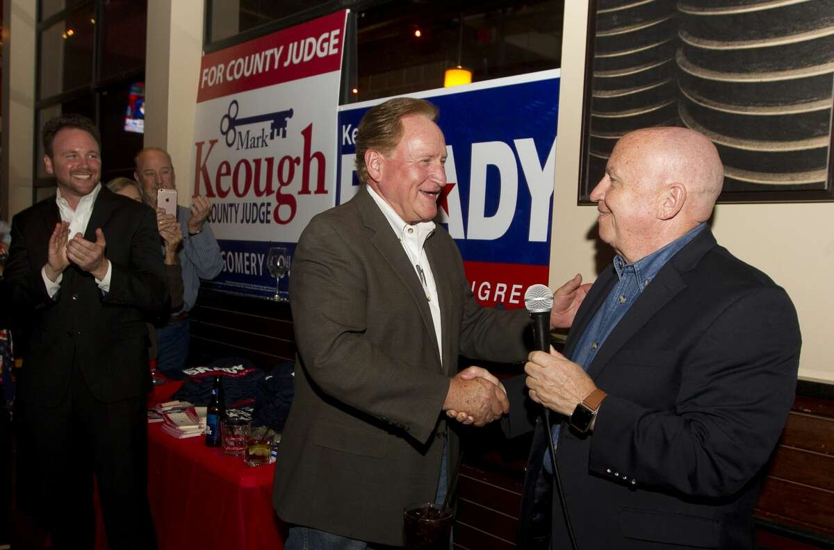 Republican candidate Mark Keough, left, shakes hands with Congressman Kevin Brady as Keough is announced as the newly elected Montgomery County Judge at a campaign party at BJ's Restaurant & Brewhouse, Tuesday, Nov. 6, 2018, in Shenandoah.