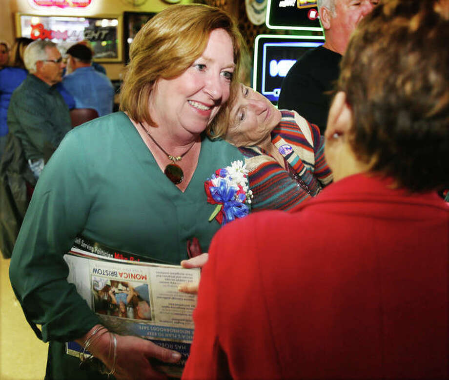 A happy Monica Bristow, Democratic incumbent state representative in the 111th District, talks to well-wishers Tuesday night at Pete's Lounge in Alton. Bristow successfully defended her seat against Republican challenger Mike Babcock. Photo: John Badman | The Telegraph