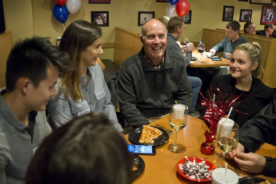 U.S. Rep. John Moolenaar, center, chats with supporters during a midterm election watch party for local Republicans on Tuesday, Nov. 6, 2018 at Pizza Sam's in Midland. (Katy Kildee/kkildee@mdn.net) Photo: (Katy Kildee/kkildee@mdn.net)