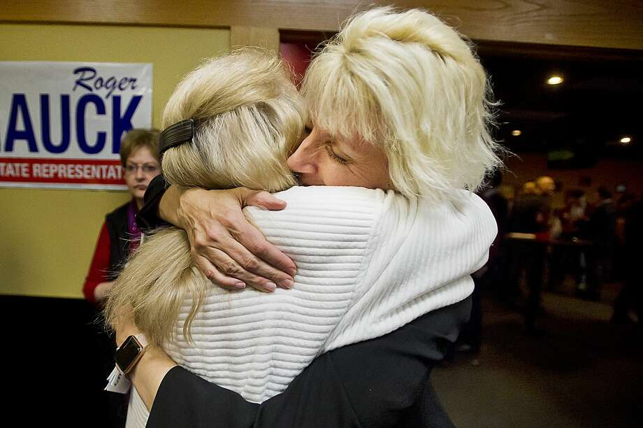 Annette Glenn, right, hugs supporter Gretchen Ziehmer, left, during a midterm election watch party for local Republicans on Tuesday, Nov. 6, 2018 at Pizza Sam's in Midland. (Katy Kildee/kkildee@mdn.net) Photo: (Katy Kildee/kkildee@mdn.net)