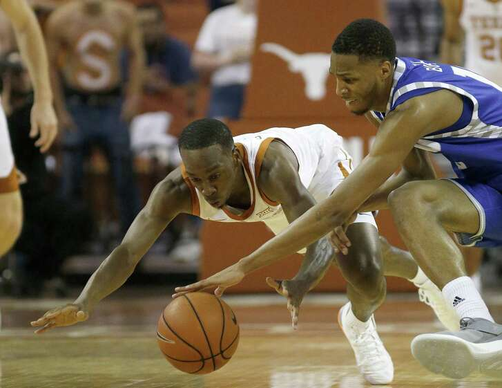 Texas' Matt Coleman fights for a loose ball with Eastern Illinois' Cam Burrell in the Horns' season-opening win.