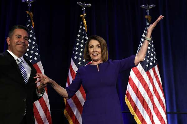 "House Minority Leader Nancy Pelosi, a Democrat from California, right, and Democratic Congressional Campaign Committee (DCCC) Chairman Ben Ray Lujan, a Democrat from New Mexico, greet guests at a House Democratic election night event in Washington, D.C., U.S., on Tuesday, Nov. 6, 2018. Pelosi said, ""When Democrats win - and we will win tonight - we will have a Congress that is open, transparent."" Photographer: Yuri Gripas/Bloomberg"