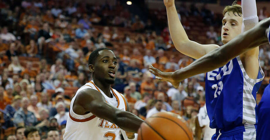 AUSTIN, TX - NOVEMBER 6: Courtney Ramey #3 of the Texas Longhorns passes around Ben Harvey #23 of the Eastern Illinois Panthers at the Frank Erwin Center on November 6, 2018 in Austin, Texas. (Photo by Chris Covatta/Getty Images) Photo: Chris Covatta/Getty Images