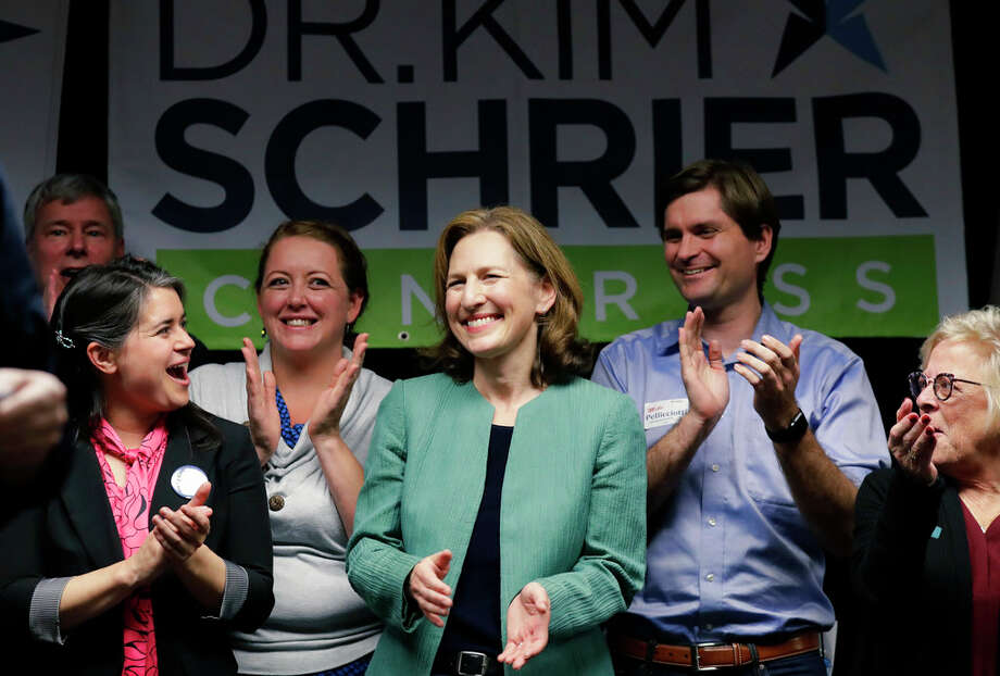 Dr. Kim Schrier, center the Democrat challenging Republican Dino Rossi for Washington state's 8th District Congressional seat, stands with local and state race candidates as she waits to speak, Monday, Nov. 5, 2018, during a campaign event in Auburn, Wash. (AP Photo/Ted S. Warren) Photo: Ted S. Warren/AP / Copyright 2018 The Associated Press. All rights reserved.