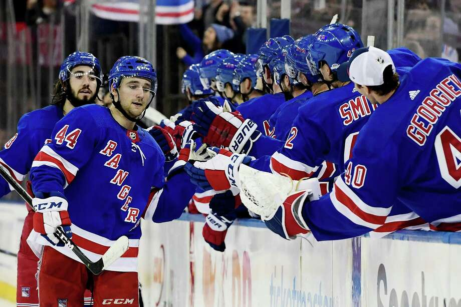 NEW YORK, NY - NOVEMBER 06: Neal Pionk #44 of the New York Rangers high-fives his teammates after scoring a goal in the third period that put the Rangers up 4-3 over the Montreal Canadiens during the game at Madison Square Garden on November 6, 2018 in New York City. (Photo by Sarah Stier/Getty Images) Photo: Sarah Stier / 2018 Getty Images