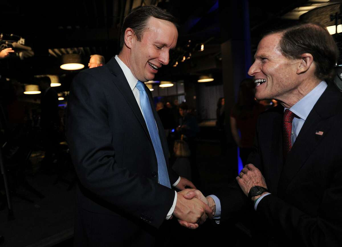 Senator Chris Murphy, left, is congratulated by Senator Richard Blumenthal following his reelection at Dunkin Donuts Park in Hartford, Conn. on Tuesday, November 6, 2018.