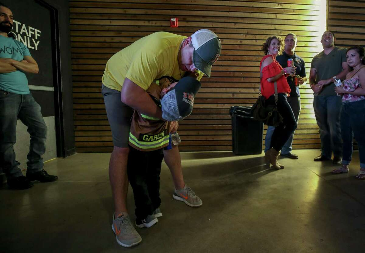 Houston Fire Department Station 2 Captain Vincent Garcia, 35, hugs and kisses his five-year-old son Easton while waiting for results during a Prop B watch party at the White Oak Music Hall Tuesday, Nov. 6, 2018, in Houston.