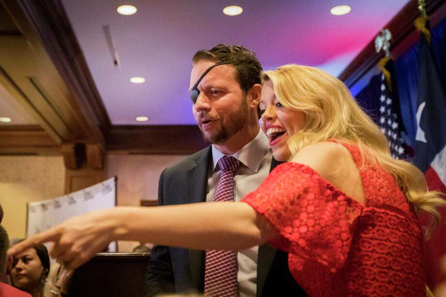 Dan Crenshaw and his wife Tara Crenshaw greet supporters the night of his victory in the Texas' 2nd Congressional District, Tuesday, Nov. 6, 2018, in Houston. Photo: Marie D. De Jesús, Staff Photographer / © 2018 Houston Chronicle
