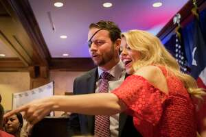 Dan Crenshaw and his wife Tara Crenshaw greet supporters the night of his victory in the Texas' 2nd Congressional District, Tuesday, Nov. 6, 2018, in Houston.