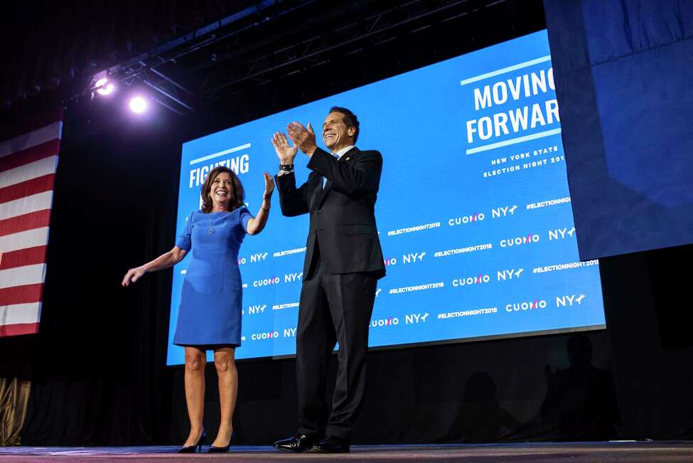 Lt. Gov. Kathy Hochul and Gov. Andrew Cuomo celebrate as they take the stage after winning their midterm election contests, in New York, Nov. 6, 2018. Cuomo was resoundingly elected to a third term as governor of New York on Tuesday, riding Democratic enthusiasm in a deep blue state to beat back his Republican challenger and capture a victory for the party?'s old guard. (Karsten Moran/The New York Times)