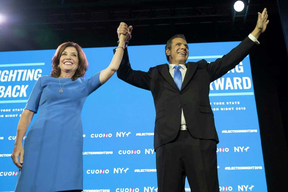 New York Gov. Andrew Cuomo, right, stands with Lieutenant Governor Kathy Hochul during an an election night watch party hosted by the New York State Democratic Committee, Tuesday, Nov. 6, 2018, in New York. (AP Photo/Mary Altaffer)