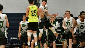 Shenendehowa celebrates during the Section II boys' volleyball final against Bethlehem at Rensselaer High School on Tuesday, Nov. 6, 2018 in Rensselaer, N.Y. (Lori Van Buren/Times Union)