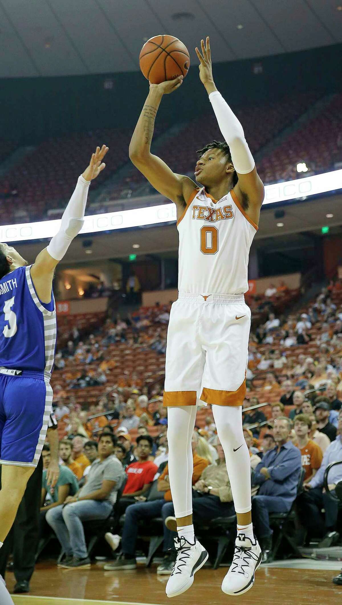 AUSTIN, TX - NOVEMBER 6: Gerald Liddell #0 of the Texas Longhorns shoots over Sharif Smith #5 of the Eastern Illinois Panthers at the Frank Erwin Center on November 6, 2018 in Austin, Texas.