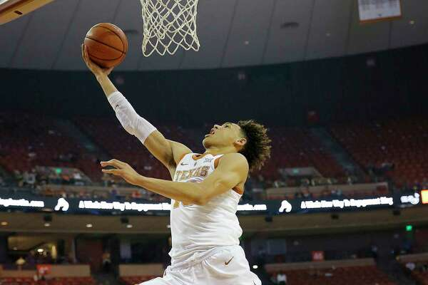 AUSTIN, TX - NOVEMBER 6: Jaxson Hayes #10 of the Texas Longhorns leaps to the basket over Ben Harvey #23 of the Eastern Illinois Panthers at the Frank Erwin Center on November 6, 2018 in Austin, Texas.