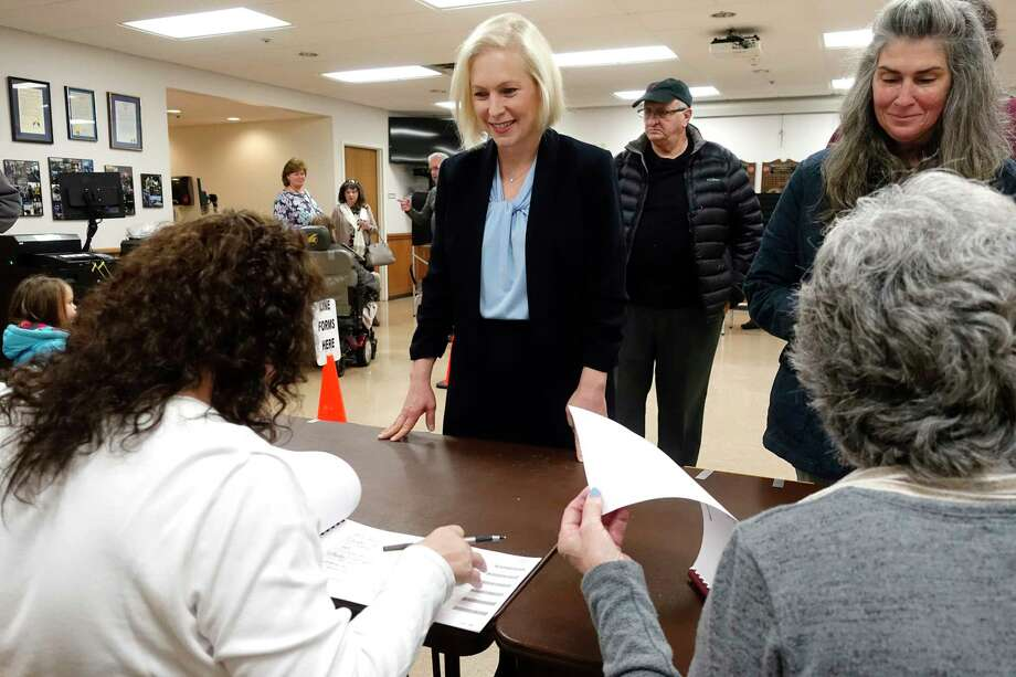 U.S. Sen. Kirsten Gillibrand, left, checks in to vote at the Brunswick Fire Co. No 1 on Tuesday, Nov. 6, 2018, in Troy, N.Y. She was facing a challenge from Republican Chele Farley. (Paul Buckowski/Times Union) Photo: Paul Buckowski / (Paul Buckowski/Times Union)