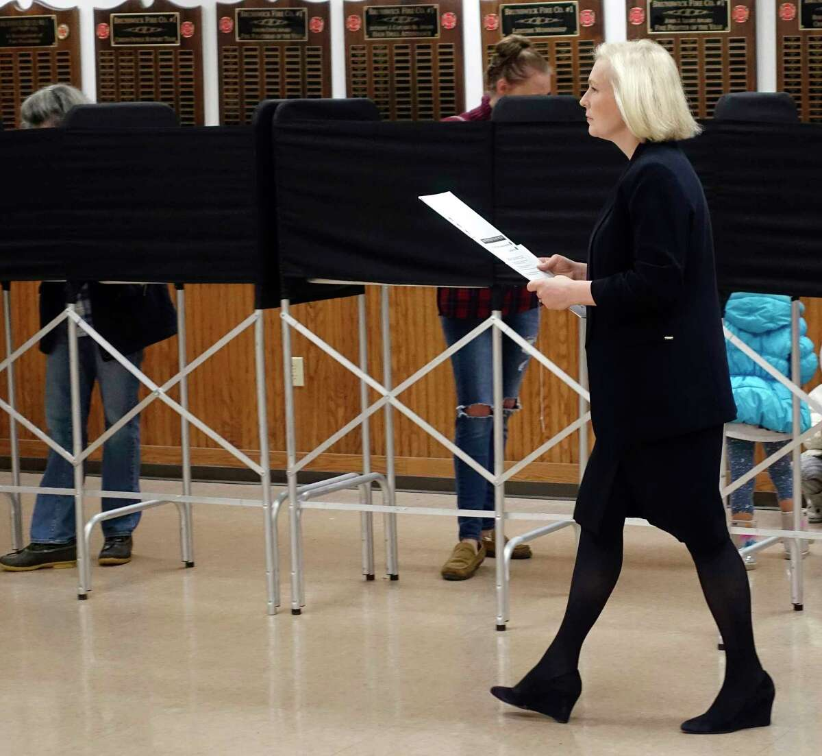 U.S. Senator Kirsten Gillibrand carries her ballot over to the voting machine to input the ballot at the Brunswick Fire Co. No 1 on Tuesday, Nov. 6, 2018, in Troy, N.Y. (Paul Buckowski/Times Union)
