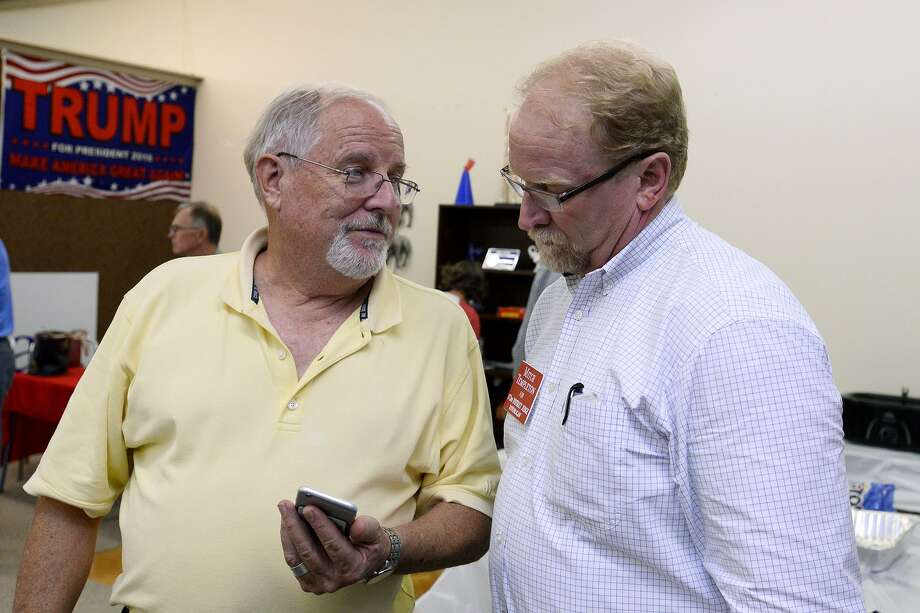 David Bradley, left, and Mitch Templeton, Republican candidate for the 172nd district judge, discuss election results at the Jefferson County Republican Party's election party in Port Neches on Tuesday.   Photo taken Tuesday 11/6/18  Ryan Pelham/The Enterprise Photo: Ryan Pelham / The Enterprise / ©2018 The Beaumont Enterprise