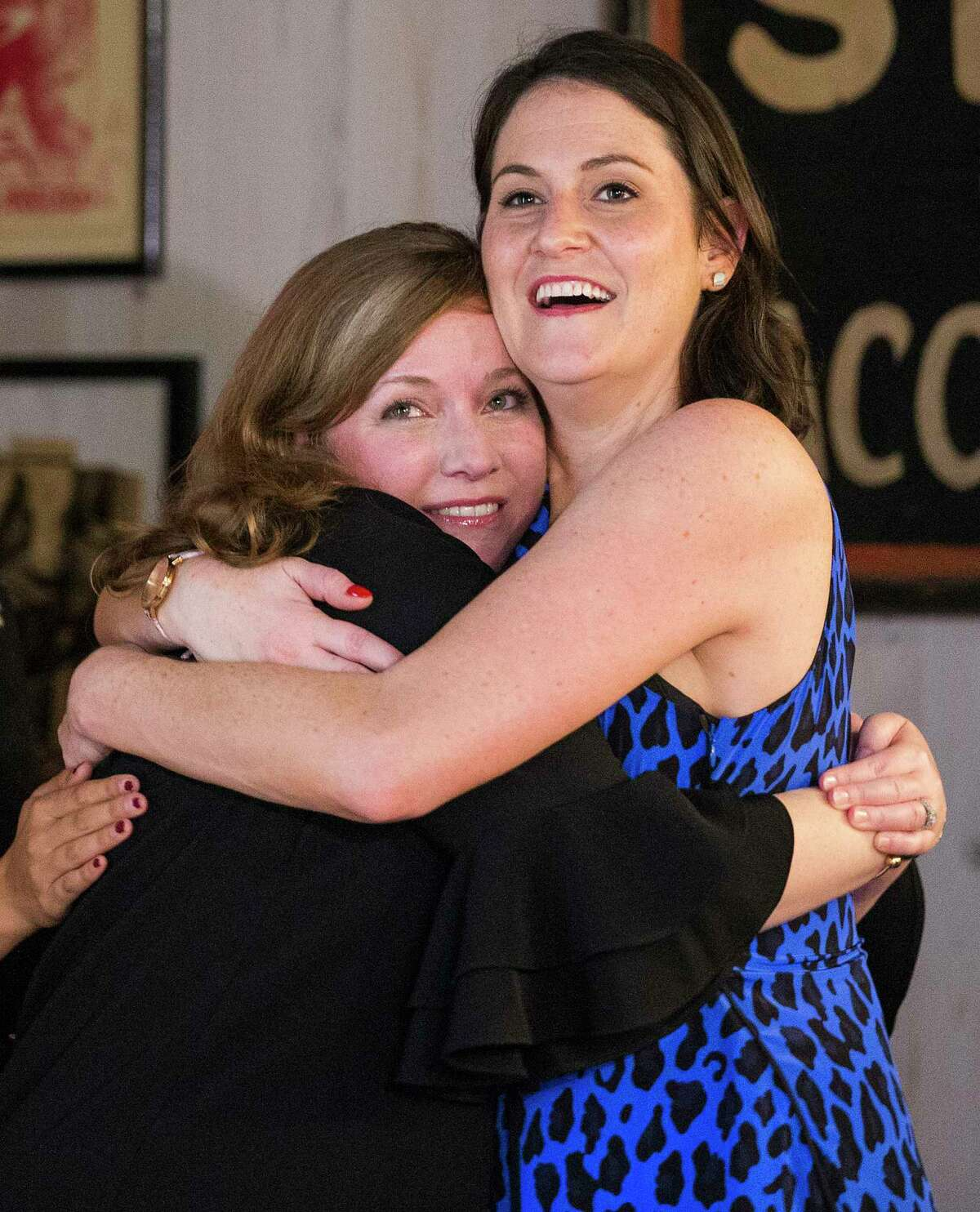 Democrat Lizzie Pannill Fletcher, left, celebrates her win over Republican John Culberson in the race for the 7th Congressional District seat in the House of Representatives, with her campaign manager Erin Minceberg on Tuesday, Nov. 6, 2018, in Houston.