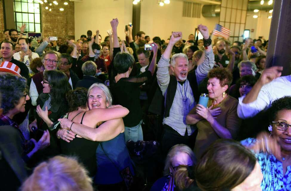 Democrats cheer as results are announced at the Antonio Delgado election night party on Tuesday, Nov. 6, 2018, in Kingston, N.Y. Delgado took the 19th Congressional District seat from Republican incumbent John Faso. (Will Waldron/Times Union)