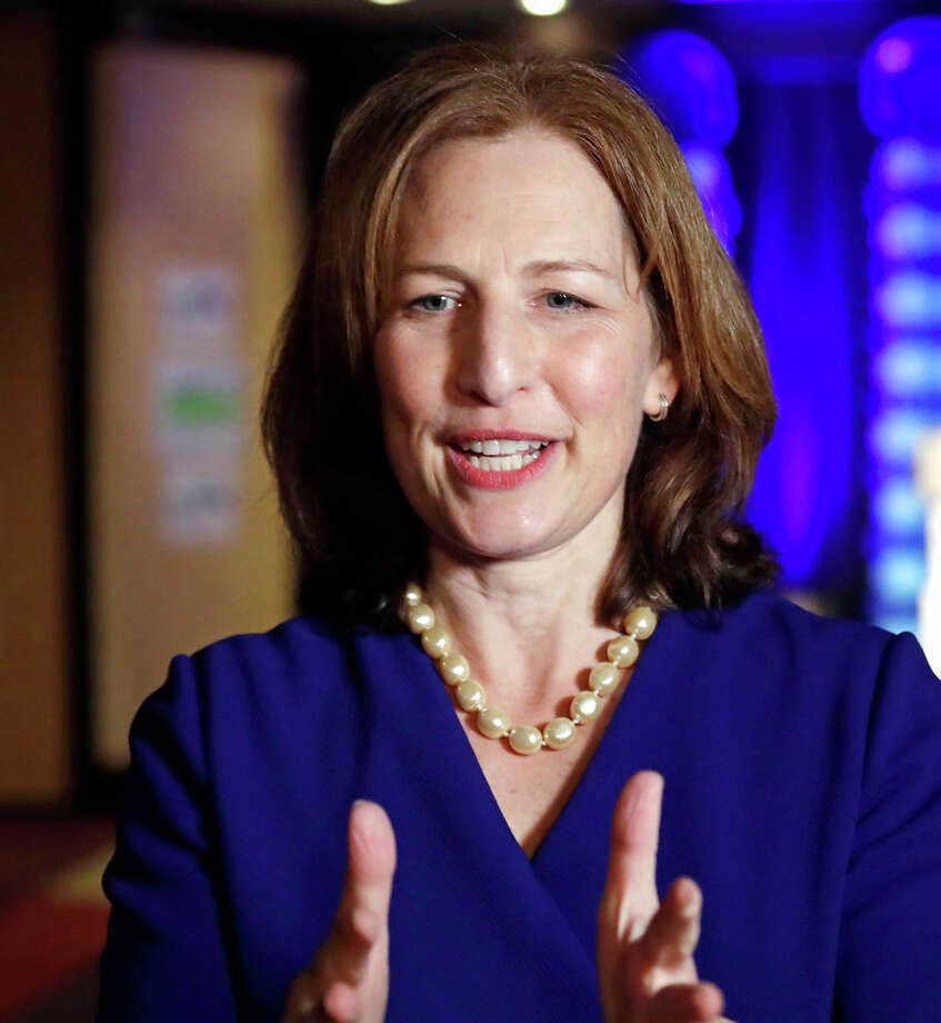 In the catbird seat:  Congressional candidate Kim Schrier speaks with reporters at an election night party for Democrats Tuesday in Bellevue.  She leads in the 8th District race, due to strong showing in King County. Photo: Elaine Thompson/AP / Copyright 2018 The Associated Press. All rights reserved